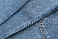 Текстура голубых джинсов как предпосылка стоковое фото
