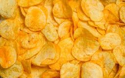 Текстура картофельных чипсов стоковые изображения