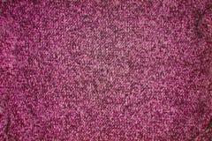Темная розовая связанная предпосылка картины текстуры стоковое фото