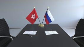 Флаги Гонконга и России и бумаги на таблице Переговоры и подписание международного соглашения схематическо иллюстрация вектора