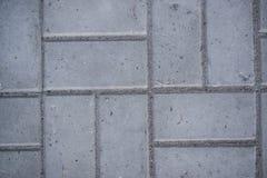 Цементная плитка. The rectangular pattern of the cement tiles grey Royalty Free Stock Photo