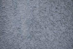 Цементная поверхность крупным планом. Background of uneven cement surface is gray Stock Image