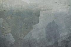 Цементная поверхность с разводами. Stains of different color to cement surfaces Stock Photography