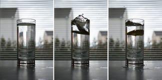 Цитрон падает в воду стоковые изображения rf