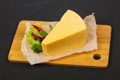 часть желтого сыра стоковое изображение