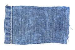 Часть джинсовой ткани стоковое фото
