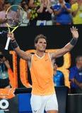 Чемпион Рафаэль Nadal грэнд слэм 17 времен Испании празднует победу после его спички полуфинала на открытом чемпионате Австралии  стоковое фото