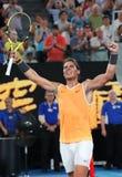 Чемпион Рафаэль Nadal грэнд слэм 17 времен Испании празднует победу после его спички полуфинала на открытом чемпионате Австралии  стоковое изображение rf