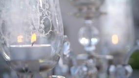 Черные свечи на подсвечниках видеоматериал