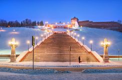 Chkalovskaya staircase in the evening illumination. Chkalovskaya staircase near the walls of the Nizhny Novgorod Kremlin in the evening illumination on a winter royalty free stock photos