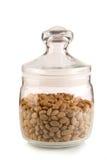 хлопья в банке. Airtight glass jar with cereal isolated on white background Stock Photos