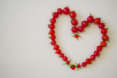 Рамка из помидоров в виде сердца. Frame of small tomatoes in the form of heart Royalty Free Stock Photo