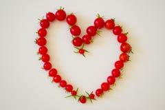 Рамка из помидоров в виде сердца. Frame of small tomatoes in the form of heart Royalty Free Stock Image