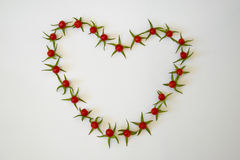 Рамка из помидоров в виде сердца. Frame of small tomatoes in the shape of a heart Royalty Free Stock Photos