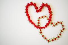 Рамка из помидоров в виде сердца. Frame of small tomatoes in the shape of a heart Royalty Free Stock Photography
