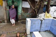 Рассыпка воды от крана в Kolkata стоковые фотографии rf