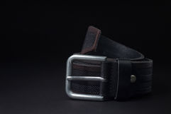 ремень. Leather belt on a black background Stock Image
