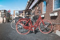 Retro red bicycle on the street near the cafe stock photography