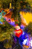 Cat on Christmas tree. Red cute kitten. New Year. royalty free stock image
