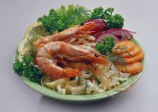Rice noodles with royal shrimp a light green plate stock photo