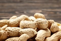 Рeanuts close up on wooden background royalty free stock image