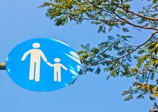 Рeople crossing traffic sign, safety concept. May be used as background royalty free stock photos