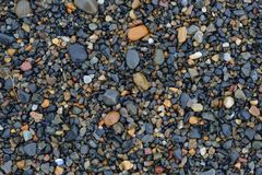 Stone gravel texture. Тhe coast of the sea of Okhotsk, North of  Khabarovsk territory, far East, Russia royalty free stock image