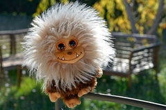Тoy small animal. Cheerful detsy toy with fluffy hair Royalty Free Stock Photos