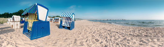 Тraditional wooden beach chairs on the coast of Baltic Sea Stock Photo