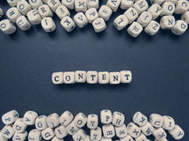 РWord Content of small white cubes on a dark background Royalty Free Stock Photos
