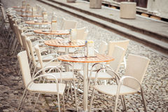 Row of little tables with chairs  in open cafe Royalty Free Stock Image