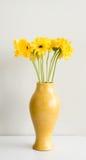 Żółci gerberas w żółtej wazie Fotografia Stock