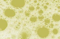 Żółci mydlani bąble Dla tła Zdjęcia Royalty Free