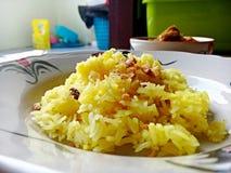 Żółci ryż w naczyniu Fotografia Royalty Free