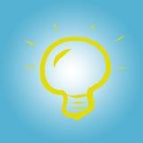Żółta żarówka na błękitnym tle Fotografia Stock