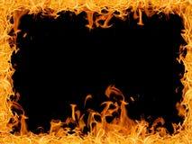 Żółta jaskrawa wielkiego ogienia rama odizolowywająca na czerni obraz royalty free