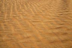 Żółta piasek powierzchnia pustynia Wiatr zamiata piasek, Obraz Stock