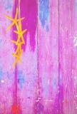 Żółta rozgwiazda na różowym tle fotografia stock