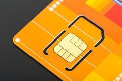 Żółta sim karta zdjęcia stock