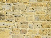 Żółta stara kamiennej ściany tekstura Zdjęcia Royalty Free