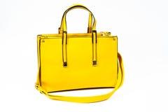 Żółta torby torebka odizolowywająca Obraz Stock