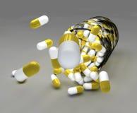 Żółte pigułki i butelka Fotografia Stock