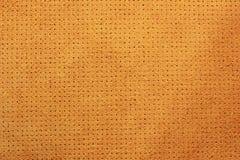 Żółtego aksamita tekstury dziurkowaty rzemienny tło Obraz Royalty Free