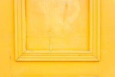 Żółtego tła jaskrawy ramowy drzwi Obrazy Stock