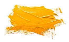 Żółtej ochry uderzenia farby muśnięcie odizolowywający obraz royalty free