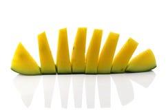 Żółty arbuz w kawałka bielu tło obraz stock