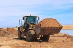Żółty buldożer przy budową Zdjęcia Royalty Free