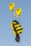 Żółty dźwigowy haczyk Fotografia Stock