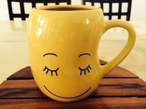 Żółty filiżanka uśmiech Obraz Royalty Free