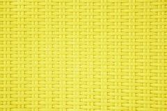 Żółty klingeryt wyplata deseniowego tekstury tło Zdjęcia Stock